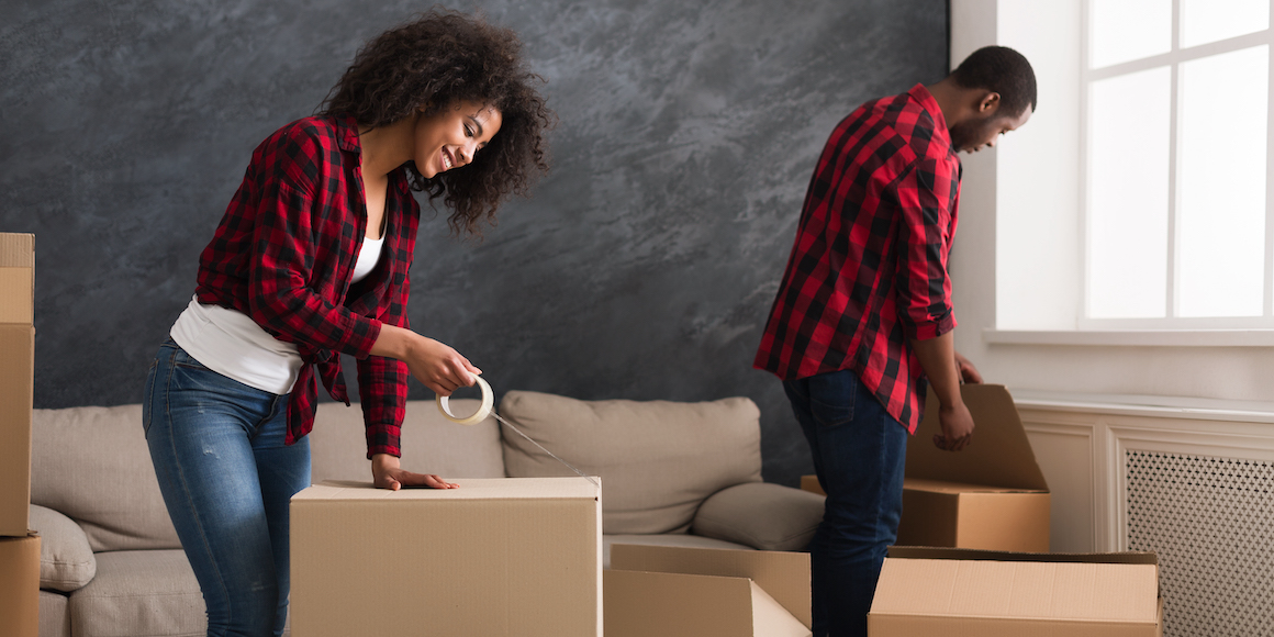 young couple packing boxes at home