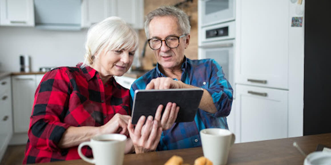 Couple discussing finances on iPad