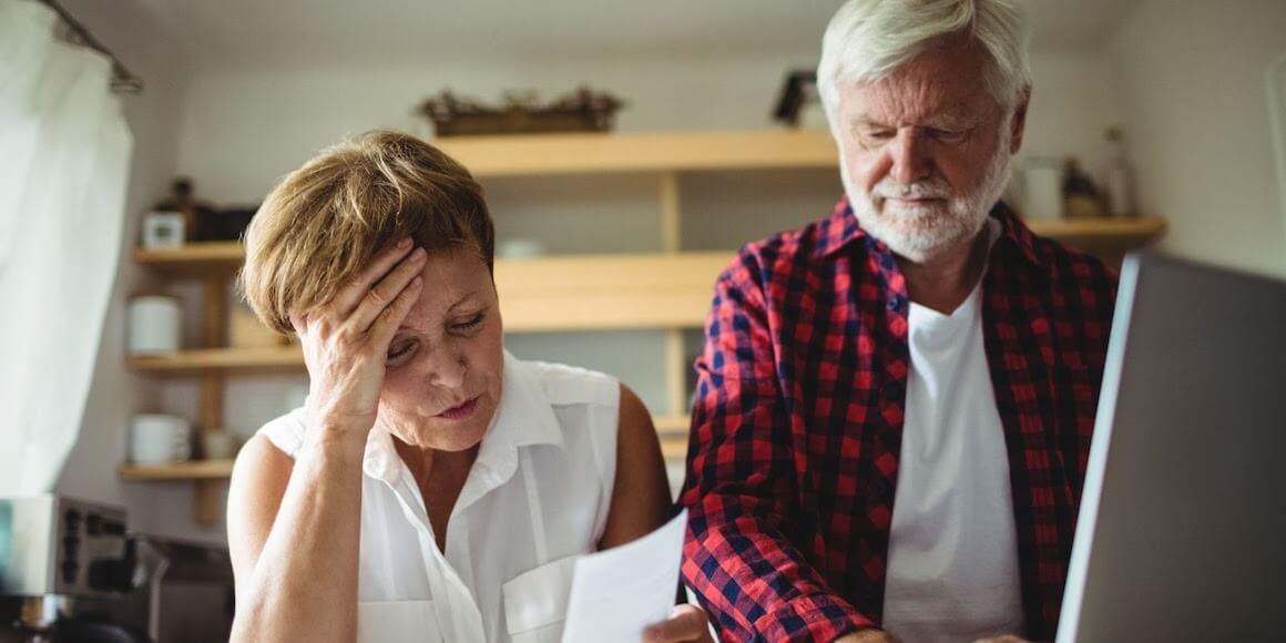 Elderly couple going over finances