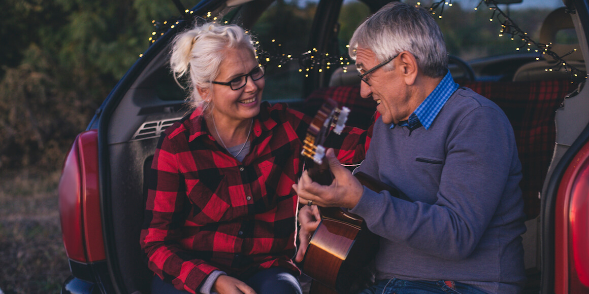 Retired couple playing the guitar