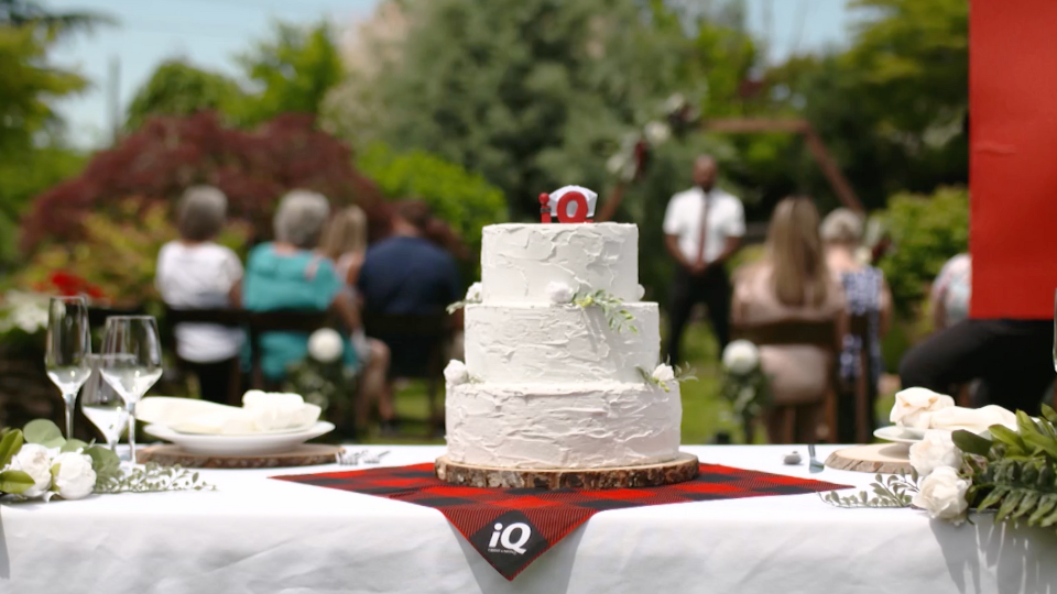 wedding cake on table with iQ Credit Union tablecloth