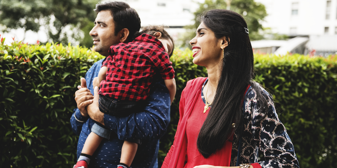young family with child - iQ Credit Union Blog