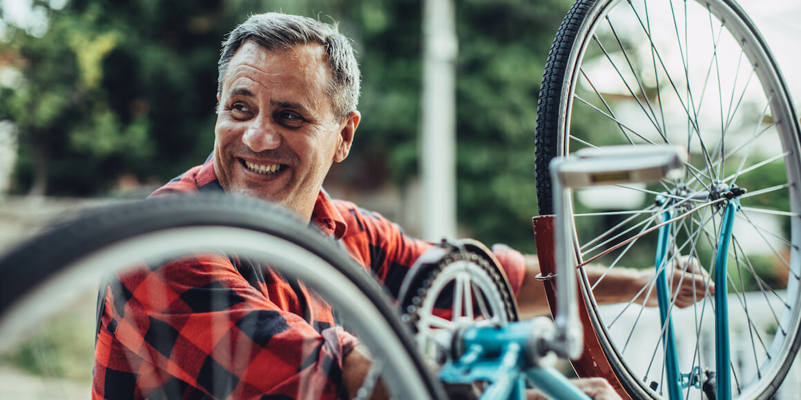 Man fixing his bicycle.